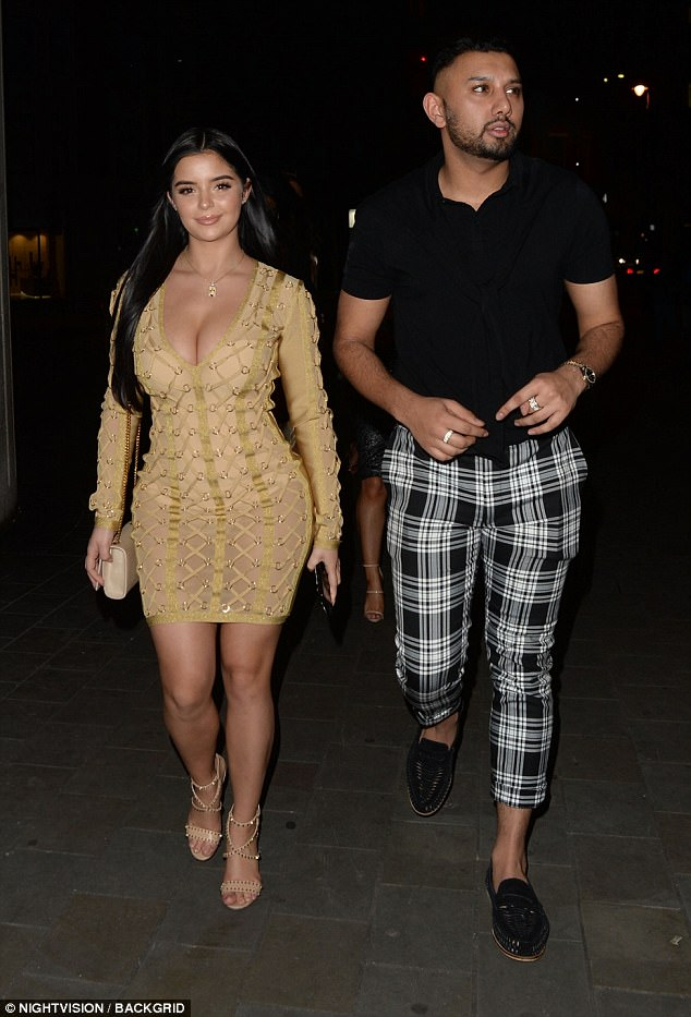 Busty Demi Rose Mawby flaunts her stunning hourglass figure in deep-plunging gold dress