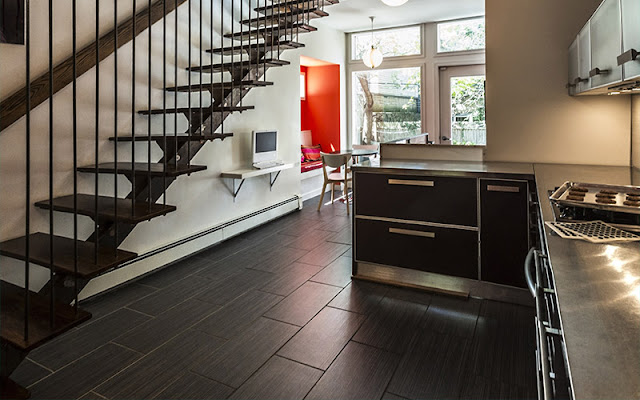 Dark hardwood floors work best in this contemporary space