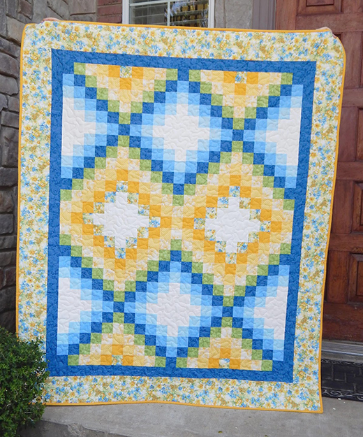 Happy Garden Quilt made by Shannon of The Flemings Nine,The Free Pattern Designed by Kona Bay Fabrics