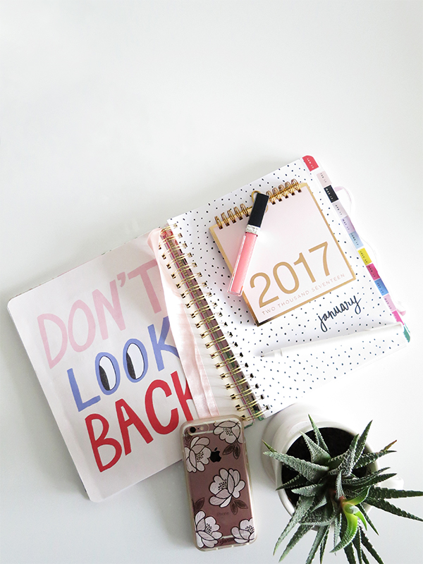 Bando 2017 pink floral 18-month day planner #omgbandoagenda, Russell + Hazel pink and gold desktop calendar, Poppin white pen, Dior lip gloss, Sonix iPhone 6 case, rose gold iPhone, succulent, Anthropologie monogram mug