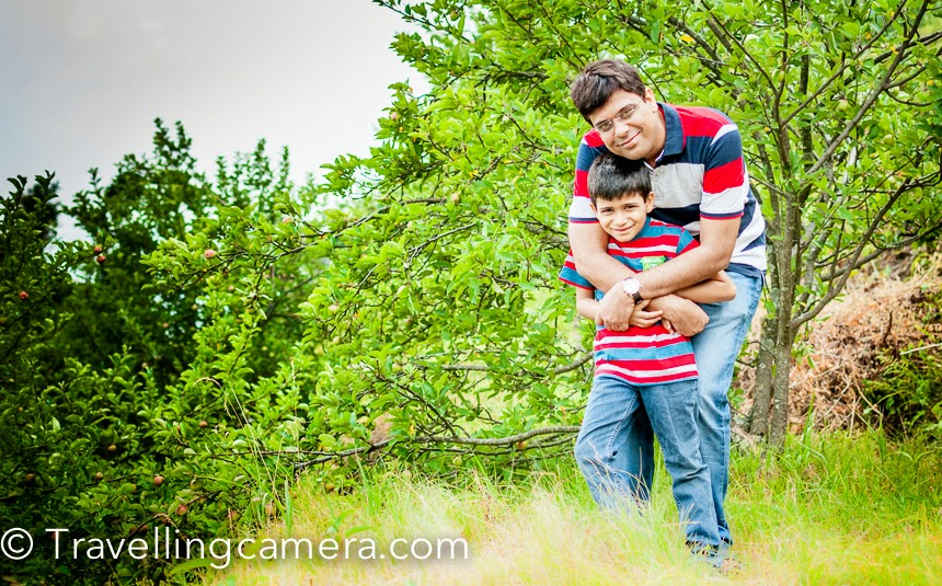 Travelling solo, or with friends or even with your partner is completely different than travelling with kids. So far I have travelled solo most of the times and recently started travelling with my nephew and niece. This exposed me to different experiences. Here I would be sharing the way things which changes and some of the tips for folks who plan to travel with kids. And I am sure that many of the readers, who have kids, can add to this. Ensure advance and reliable booking - When travelling with kids, it's very important and probably the first step is to plan your travel and stay bookings.  It's very important to plan the booking of comfortable medium to travel and a good place to stay. With kids you can't keep things for the last moment and ad-hoc decision won't flyHave enough time -Whenever travelling with kids, make sure that you have enough time in hand and you are not time bound. Many times, we rush through few things and you would not get that flexibility when kids are accompanying you. They have their own moods and by nature they are curious. So they may want to spend more time at some specific places which you may to skip otherwise :)Well equip your kids - It's very important to have right stuff with you when travelling with kids and that really depends upon the interest areas of your kids. If you equip them well with right things you may explore their new interests and likings. Let them handle your camera and they may surprise you with the kind of clicks they capture. Above photograph shows Nishant (my nephew) who always carries his binoculars as he loves finding birds and seeing them doing various activities. While travelling, he loves keeping a tablet or few games with him.Be ready for weather change - Most of the time, we plan our trips w.r.t. current weather at the place and I have learned it from experience that we should never underestimate the changes that may occur and distrupt your whole trip.Games, books or a tab while traveling - When you have kids with you, one needs to be extra energetic. Although you can keep some games, toys, tablet with interesting apps on it, books but be ready some instant plans. Above photograph was shot in an apple orchard for which we had trek a bit and most of us were concerned if we should do it with Nishant or not. Most of the times we try skip such activities but surprise them some time and believe me it's fun, if done carefully.Better hygiene is a must -While travelling, staying or eating we need to take appropriate precautions. So it's always recommended to keep bacterial wipes, sanitizers and bottled water with you. Also keep some water for hand wash on the way. These are very small things which make your life much easier.Keep appropriate medicine and first-aid -As a practice, as a traveller we should always keep a first aid box with us but it becomes more important when you have kids travelling with you. Ensure that all important medicines are with you, especially when you are travelling to some remote areas. If your kids having some medication, always consult your doctor for appropriate precautions and other stuff you should carry to avoid any unknowns.Decide itinerary and place to stay, which is you kid friendly -The place to stay should be fun and comfortable. The bar becomes high in terms of quality as well. When we travel solo or with friends, many times there is a tendency to compromise on place to stay because we see it as a place to spend nights. With that's completely opposite when you are with kids. Kids may want to spend more time in the resort or hotel you are choosing, so you would want to choose a place which has sufficient arrangements for your kid. Apart from the place to stay, we also need to be careful about the itinerary and it should match with your kids preferences.  Try to move out of your comfort zone -These days our kids are not exposed to many of the experiences which we had in our childhood. Travel is the best time to expose them to something different and let them experience things they had never done or thought before. This also helps them learn a lot. Like using public transport can be a completely different experience for your kid, especially in India :). Trekking to different place. Take them to local villages or fairs happening around. Big cities don't expose the kids to such experiences. Encourage your kids to set some challenging goals to add more fun to your trips. And all this definitely needs some creativity on your part. The idea is to keep them engaged with something which has fun and learning.Club Mahindra Teddy Travelogues encouraged me to write this post today.Travelling with kids is a very special experience and this also leads you to think differently & enjoy your trips. Many times you also start feeling that some kid should be part of your trip. While writing this post, I realized that many of us become very good planners and do our travelling/exploration in a disciplined way. Isn't that amazing.Please feel free to share your inputs through comments. Also share that how kids make your trips special for you.