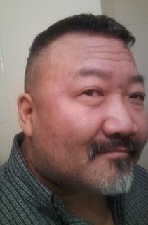 author headshot of Dwight Okita