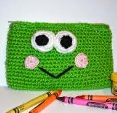 http://www.craftsy.com/pattern/crocheting/accessory/frog-amigurumi-pouch/5823