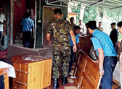 Police attach the property of Nima Tamang at his house in Kalimpong