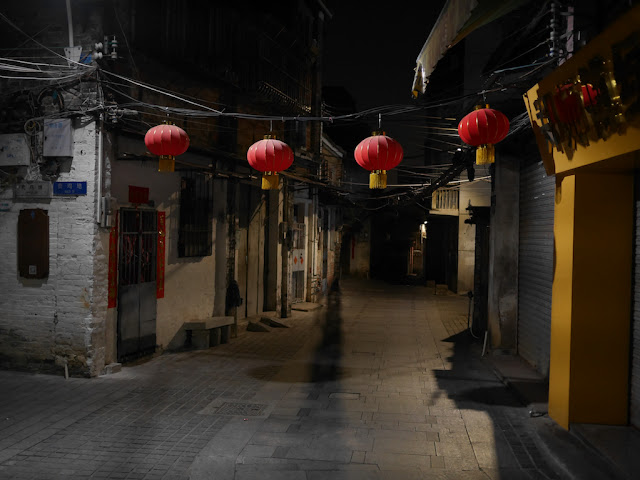 lanterns hanging on a old street in Jiangmen