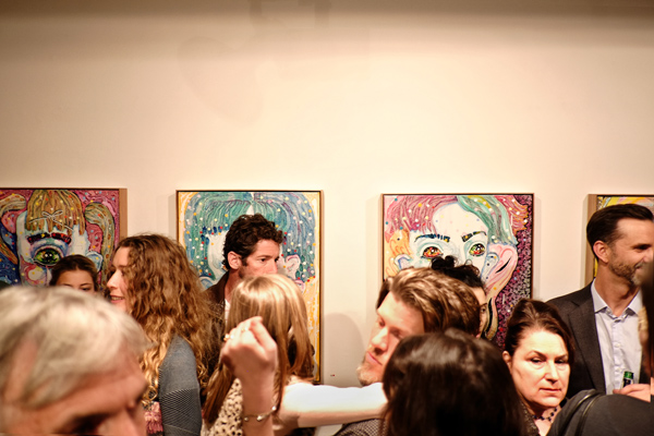 Large eye 'portraits' and opening night crowd at Roslyn Oxley9 gallery for 'angel dribble' by Del Kathryn Barton.
