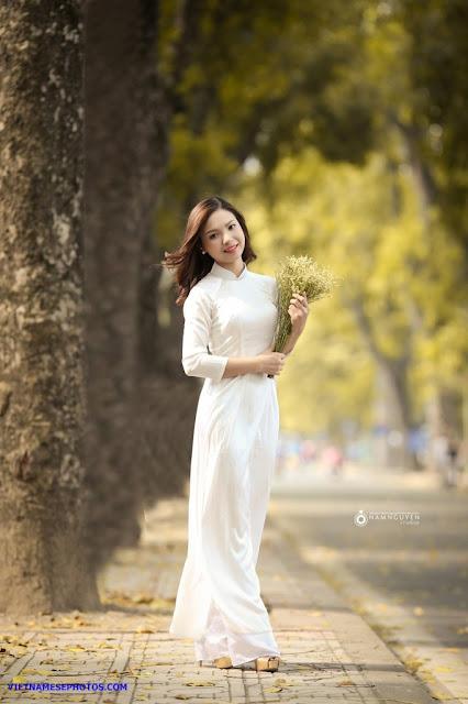 Vietnamese teen girl walking on the street with white ao dai 2