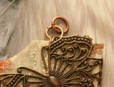 Flat stone wrapped in Vintaj filigree butterfly :: All Pretty Things