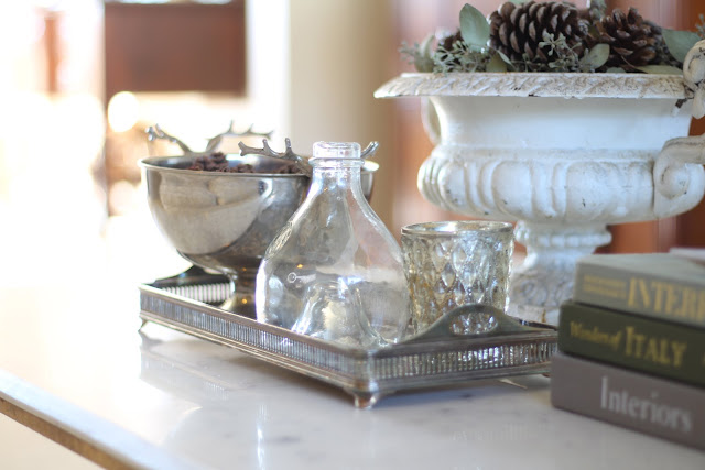 styling a coffee table silver tray candle bottle fall