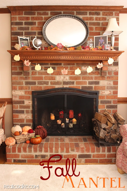 Simple fall decorating ideas for a mantel using pumpkins and inexpensive diy crafts from realcoake.com