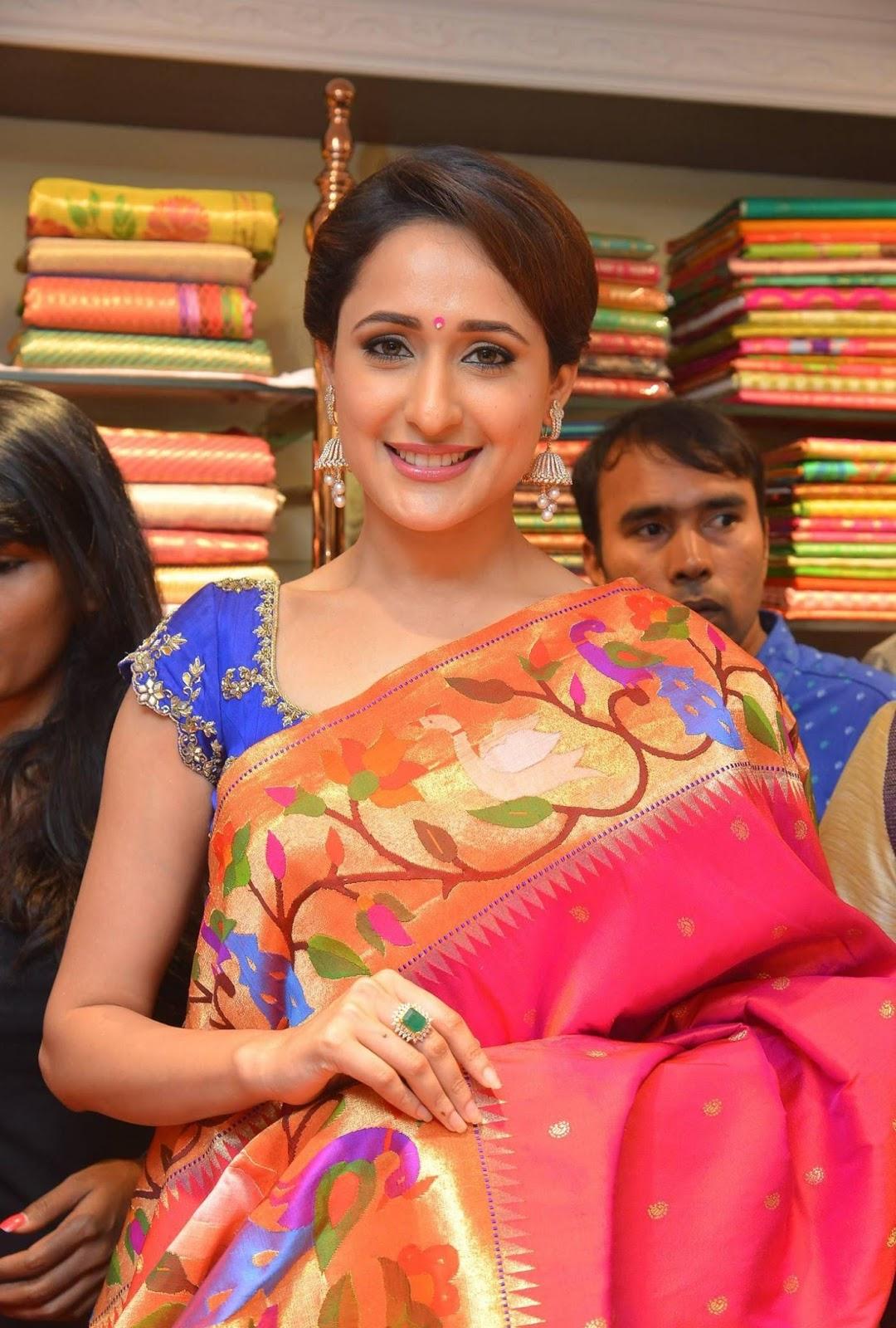 Pragya Jaiswal Hot Smiling Hip In Traditional Blue Saree At Store Launch