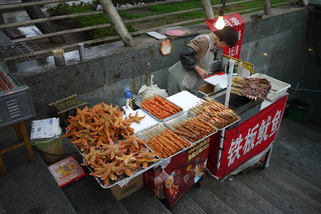 cart with food to grill and starfishes