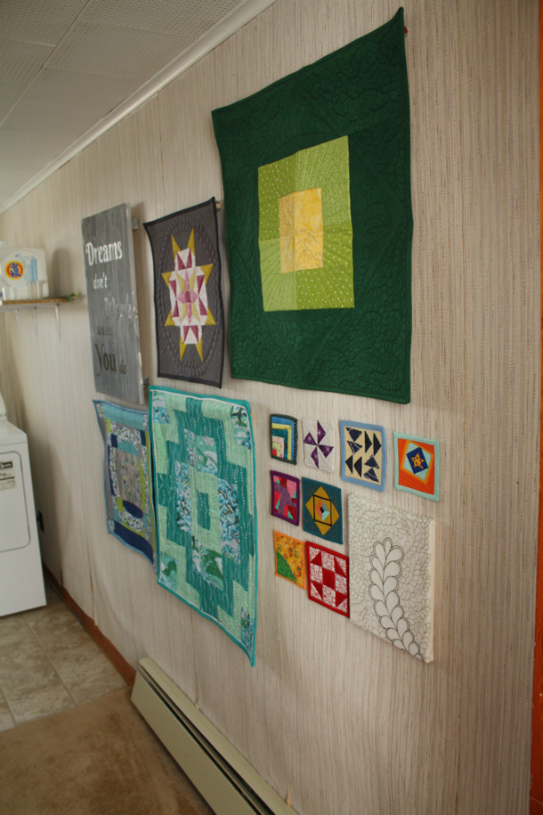 Laundry room mini quilt wall | DevotedQuilter.blogspot.com