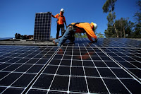 Solar installers from Baker Electric place solar panels on the roof of a residential home in Scripps Ranch, San Diego, California, U.S. October 14, 2016. Picture taken October 14, 2016. (Credit: Reuters/Mike Blake) Click to Enlarge.