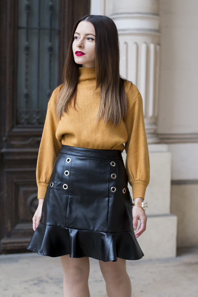 yellow sweater black skirt