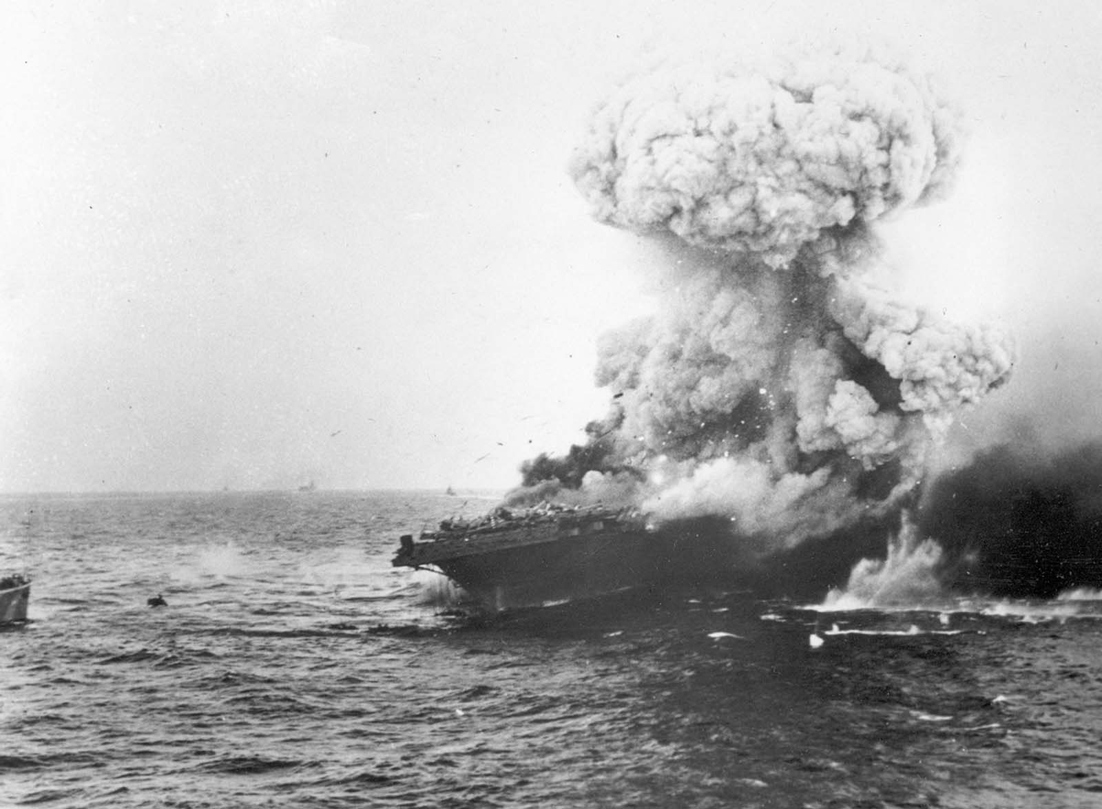 The USS Lexington explodes after being bombed by Japanese planes in the Battle of the Coral Sea in May of 1942. More than 200 of the carrier's 2,951-man crew went down with the ship. While Japanese forces won a tactical battle, a number of their damaged ships were unable to participate in the upcoming pivotal Battle of Midway, which took place one month later.