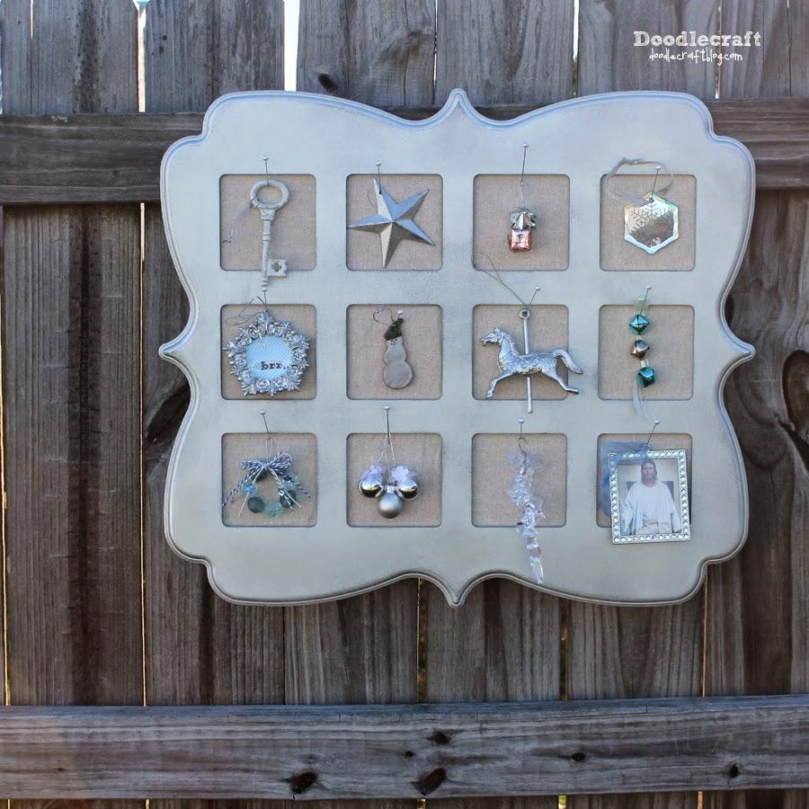 http://www.doodlecraftblog.com/2014/11/silver-shimmery-ornament-advent-calendar.html