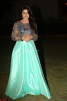 Nikki Galrani in Green Skirt  Top at Marakathamani music launch ~  Exclusive (146).JPG
