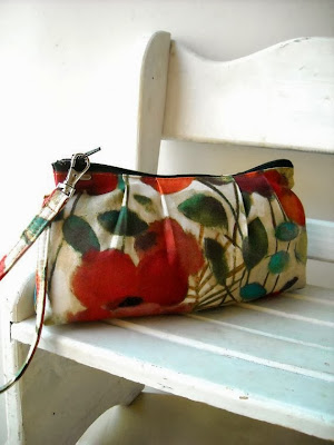 https://www.etsy.com/listing/155093705/pretty-poppies-in-red-zipper-pouch-with?ref=favs_view_7
