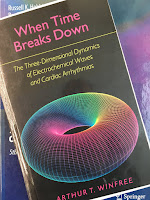 When Time Breaks Down, by Art Winfree, superimposed on Intermediate Physics for Medicine and Biology.