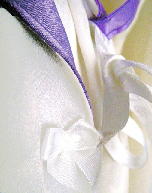 Sewing ribbon closure on satin contrast wedding robe