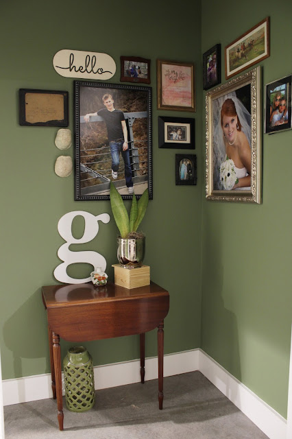 Eclectic farmhouse living room tour: Hallway Gallery Wall | House Homemade