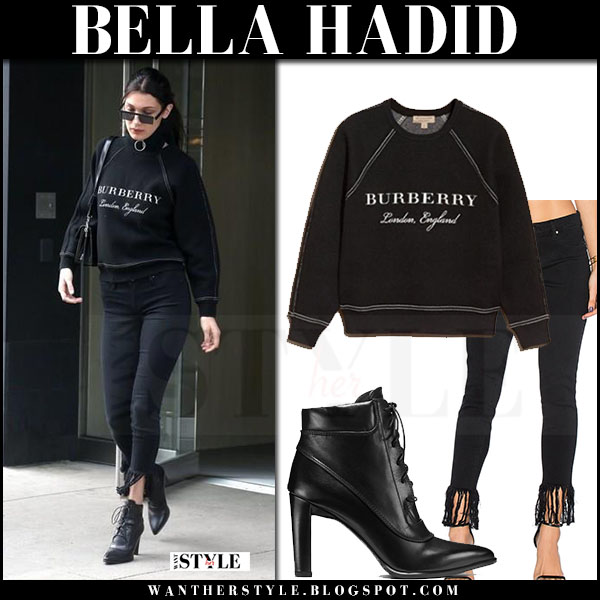 Bella Hadid in black sweatshirt, black fringes jeans blank nyc and black ankle boots stuart weitzman ruggy what she wore march 2017