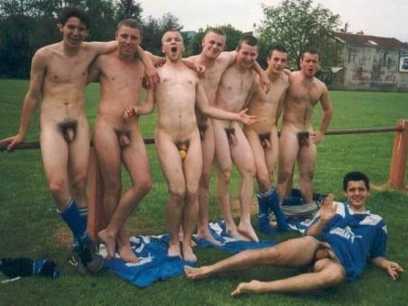 naked men playing volleyball