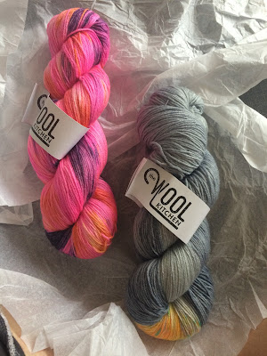 #thewoolkitchen - two hanks of variegated yarn hand-dye in acid dyes, one neon pink, one light grey