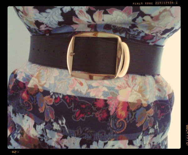 close up of waist wearing paisley wiggle dress and wide black belt with gold buckle
