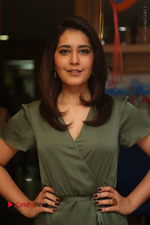 Actress Raashi Khanna Stills in Green Short Dress at Mirchi 95 Suno Aur Mercedes Jeeto Contest  0013