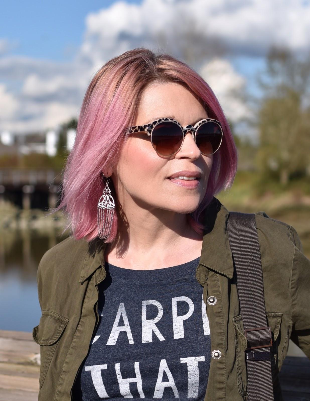 Monika Faulkner outfit inspiration - graphic tee, olive bomber jacket, Nanette sunglasses, pink hair