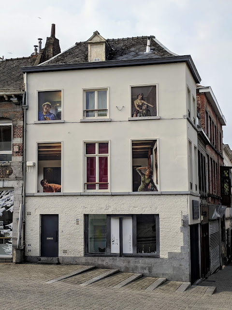 What to do in Mons Belgium: street art in building windows
