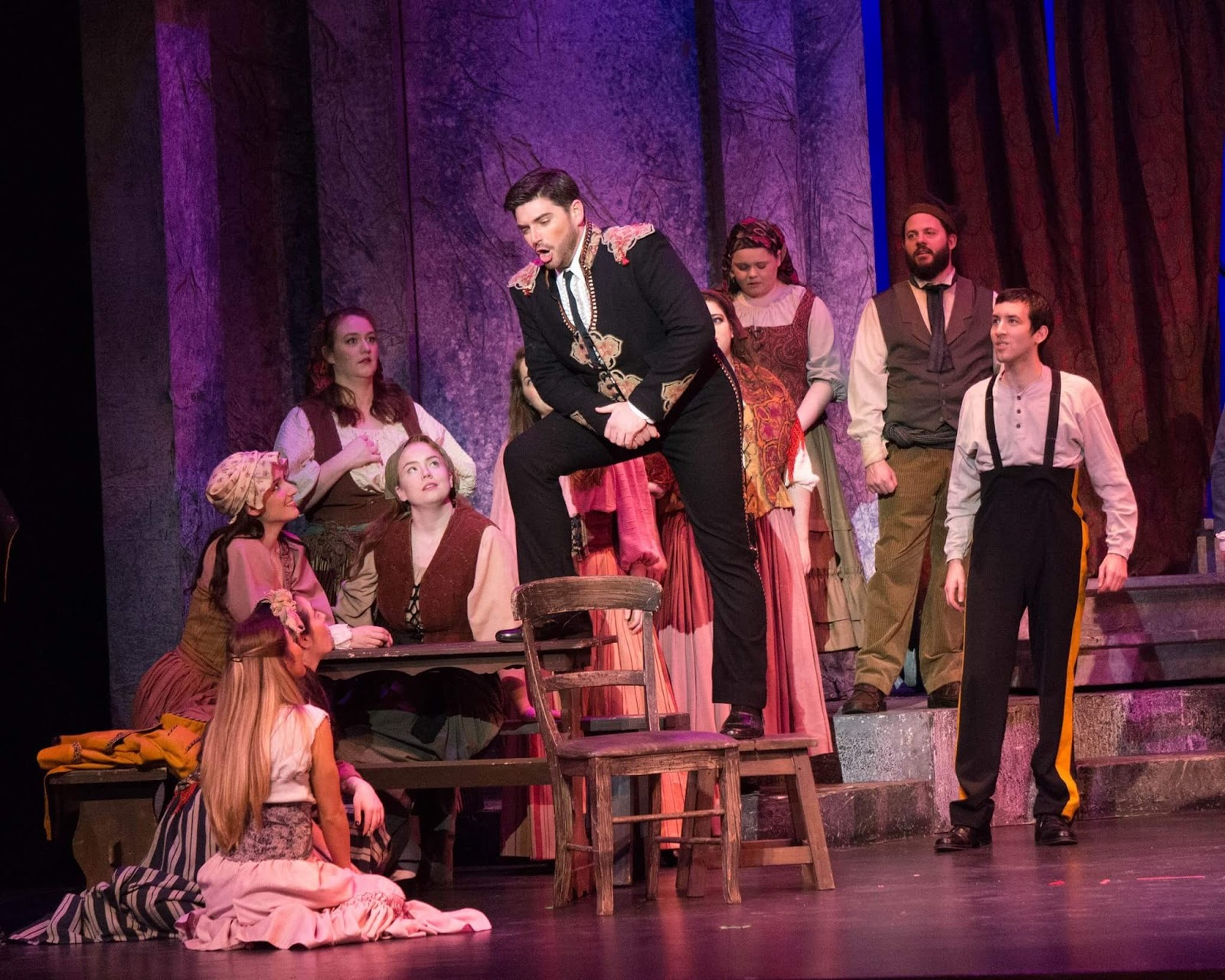IN PERFORMANCE: Baritone DAVID PERSHALL as Escamillo (center) in Greensboro Opera's production of Georges Bizet's CARMEN, January 2017 [Photo © by Greensboro Opera]