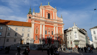 Prešeren Square has an orange building