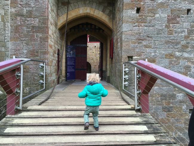 Searching For Treasure At Castell Coch Toddler running to entrance