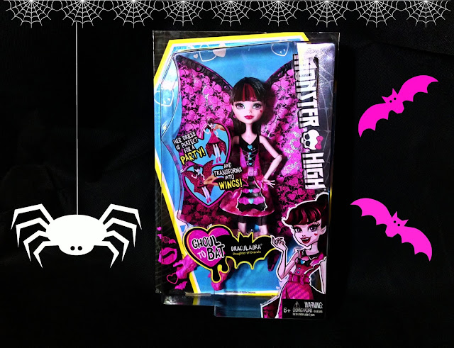 Monster High Draculaura doll with Halloween themed background