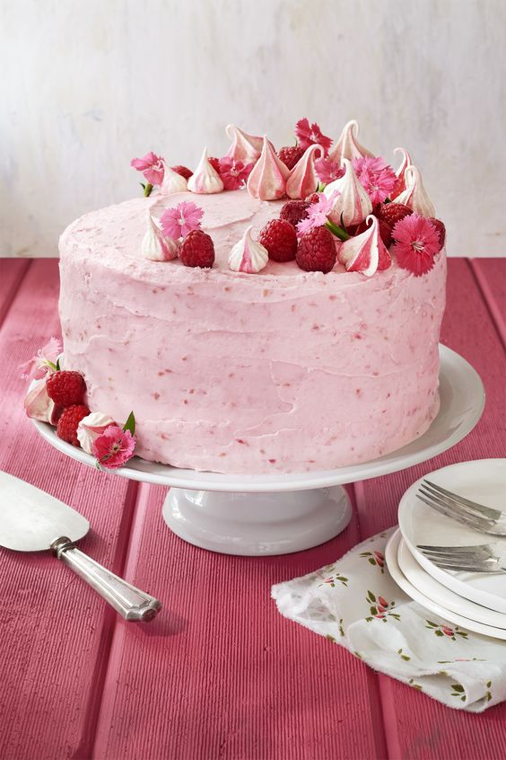 Topped with fluffy meringues and edible flowers, this pretty-in-pink raspberry velvet cake is about as springy as it gets.