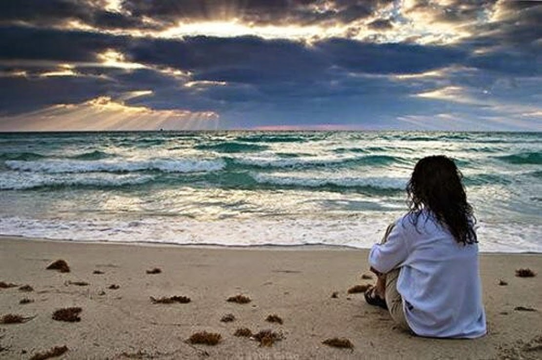 Sad-girl-alone-sitting-in-beach-watching-waves-image-picture-1111x738.jpg