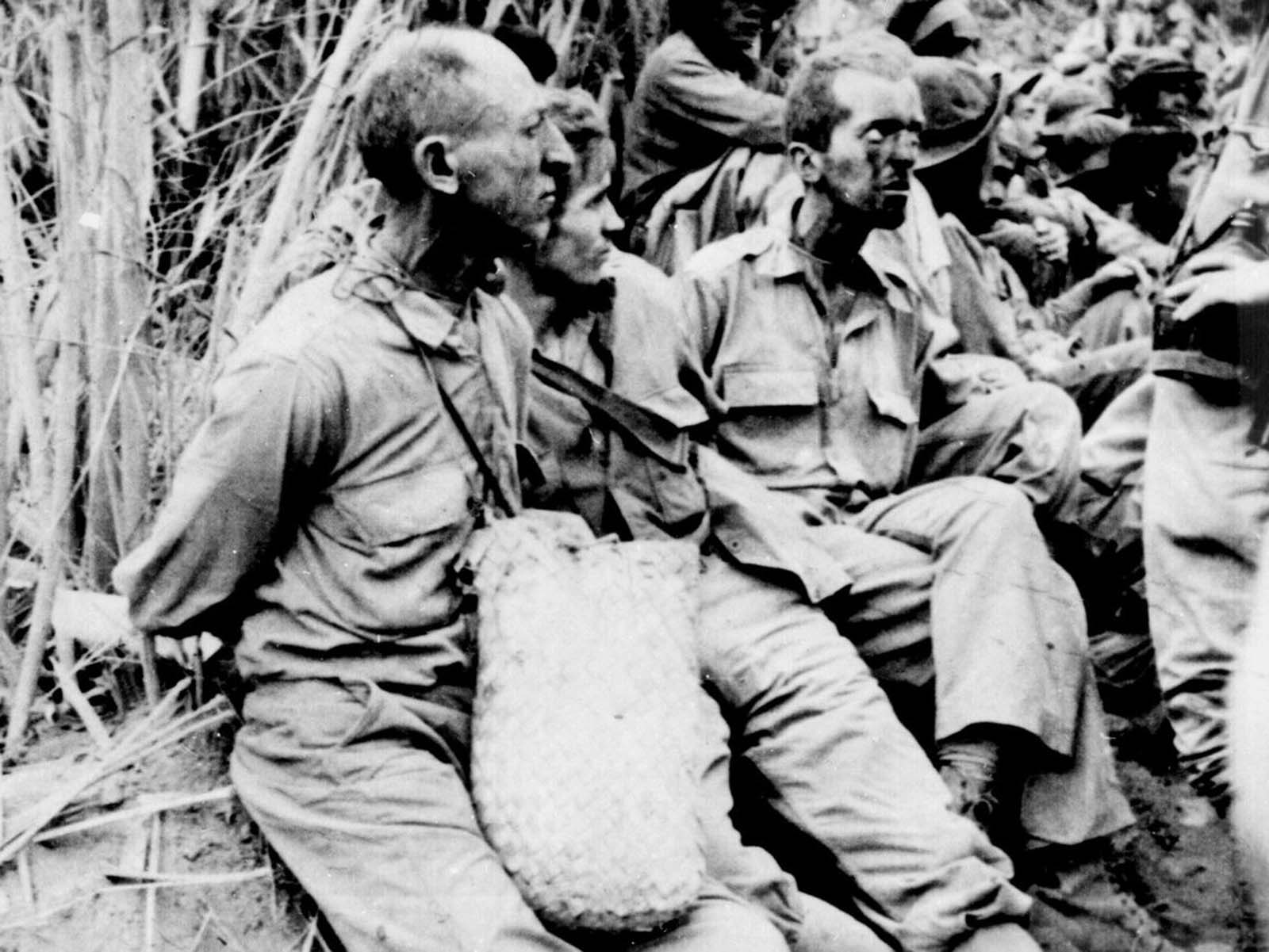 These prisoners were photographed along the Bataan Death March in April of 1942. They have their hands tied behind their backs. The estimates of the number of deaths that occurred along the march vary quite a bit, but some 5,000 to 10,000 Filipino and 600 to 650 American prisoners of war died before they could reach Camp O'Donnell. Thousands more would die in poor conditions at the camp in the following weeks.
