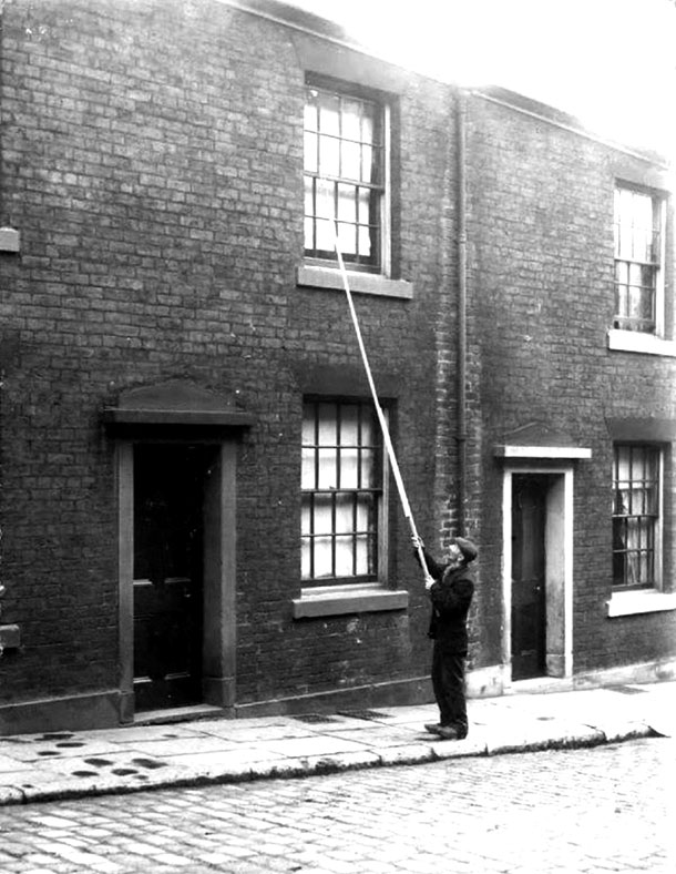 A Knocker Up with a long pole rapping on an upper window. Knocker Up. marchmatron.com