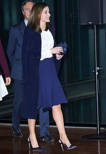 Queen Letizia wore Hugo Boss silk blouse, and skirt, wore Magrit Pumps, carried Magrit clutch, green diamond earrings, Carolina herrera coat