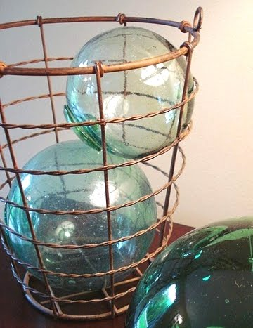 wire basket with glass floats