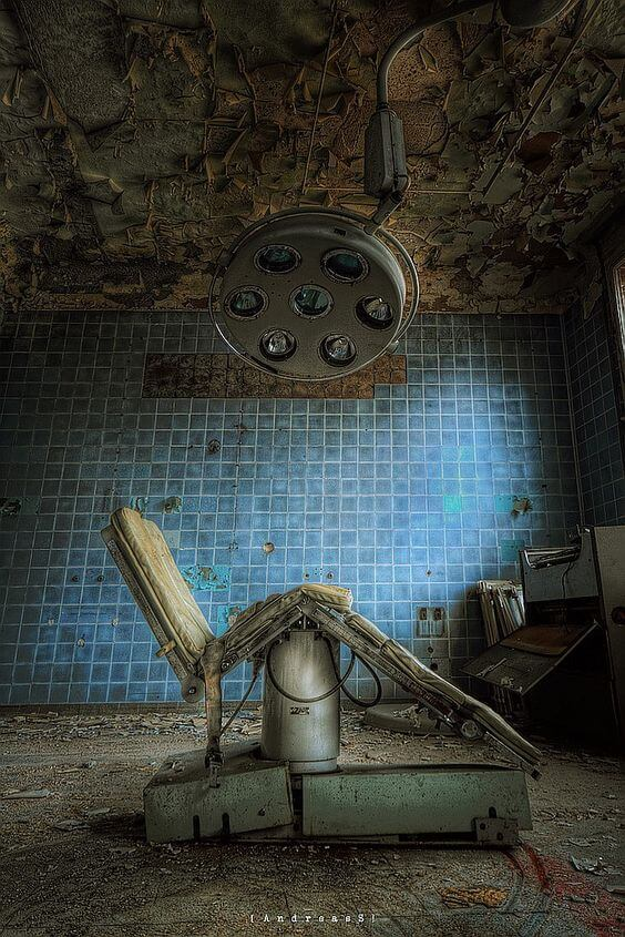 Abandoned operating lamp and chair, abandoned hospital - Germany