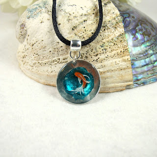 https://folksy.com/items/6941424-Pendant-3D-Fish-Handpainted-Goldfish-set-in-Resin-Necklace