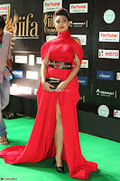 Apoorva in a Stunning Tight Leg Split Sleeveless Red Gown at IIFA Utsavam Awards 77.JPG