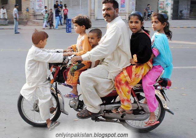 Funny Pakistani motorcyclist with children