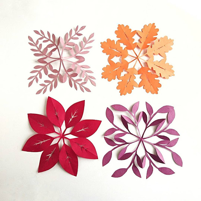 Four leafy paper snowflake designs