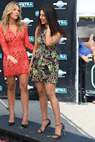 Priyanka Chopra looks super cute in happy mood wearing a short flower print dress in Hollywood 010.jpg