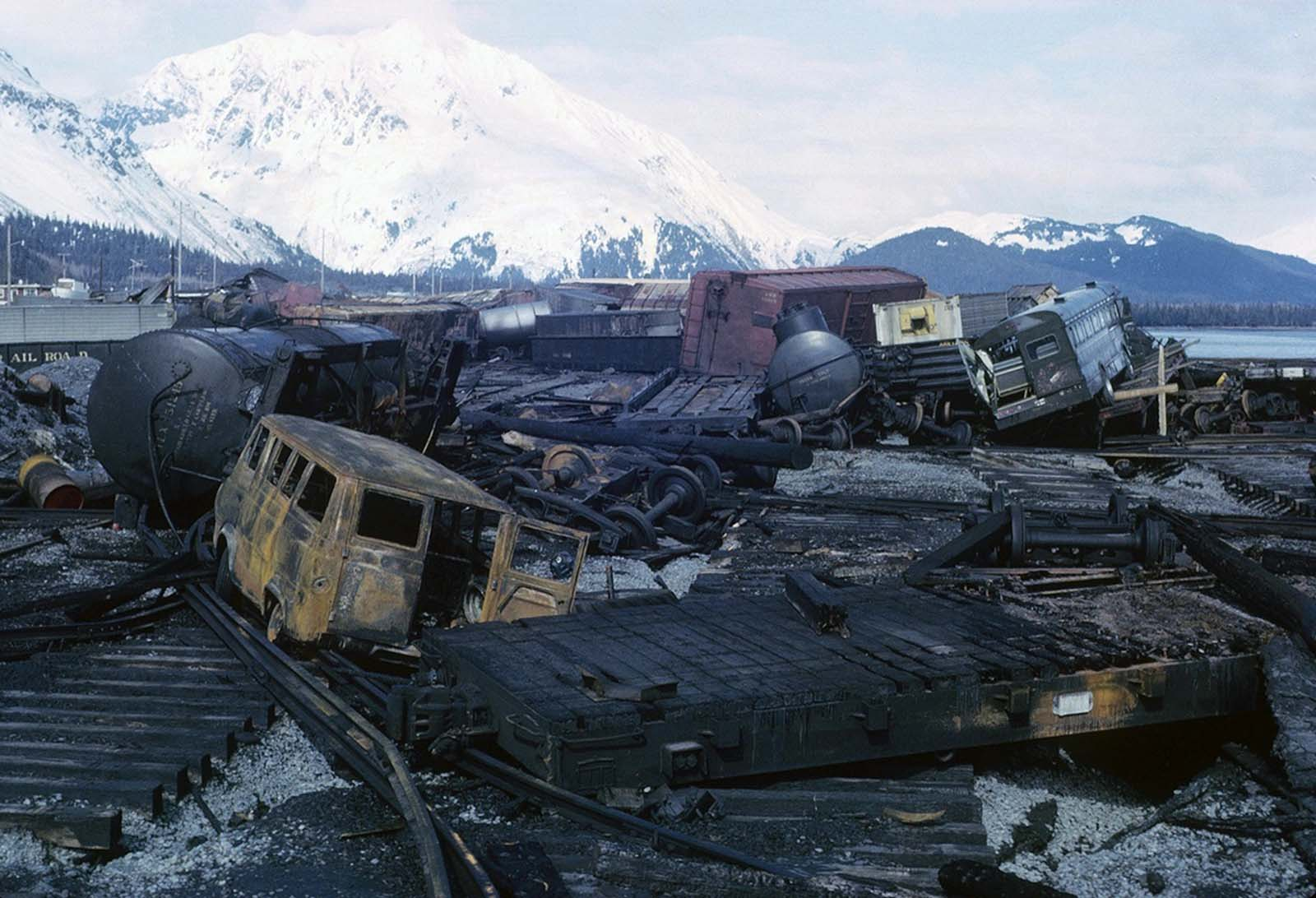 Chaos on the waterfront in Seward, burned-out vehicles and rail cars strewn across the ruined rail yard.